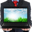 Businessman holding an open laptop — Photo