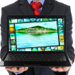 Businessman holding an open laptop — Stock Photo #20507491