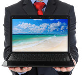 Businessman holding an open laptop — Stock Photo