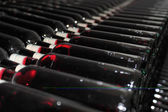 Old bottles of red wine — Stock Photo
