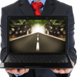Businessman holding an open laptop — Foto Stock