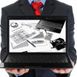 Businessman holding an open laptop — Stockfoto