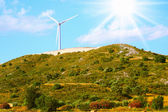 Large windmill on the hill sunny day — Stock Photo