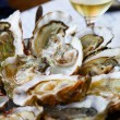 Oysters with lemon — Stock Photo