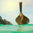 Longtail boat on setropical beach — Stock Photo #27386797