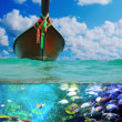 Longtail boat on setropical beach — Stock Photo #27392795