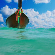 Longtail boat on setropical beach — Stock Photo #27779019