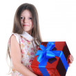 Little girl keep in hands a gift — Stock Photo #3277264