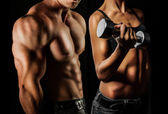 Bodybuilding. Man and  woman — Stockfoto
