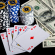 Poker chips Playing cards and dollars — Stock Photo #48031071