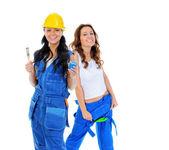 Beautiful young women doing repairs — Stock Photo