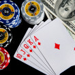 Poker chips Playing cards and dollars — Stock Photo #48396837