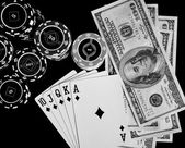 Poker chips Playing cards and dollars — Stock Photo