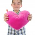 Boy gives a heart — Stock Photo #6037058
