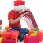 Cheerful boy in Santa Claus hat — Stock Photo #7565430