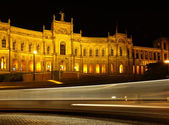 Munich - Maximilianeum at night with rays from a street car — Stock Photo