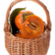 Stock Photo: Persimmons in basket on white background