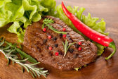 Grilled beef steak with rosemary — Stock Photo