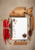Red chili pepper, cardamom, star anise and allspice. Open notebook. — Stock Photo