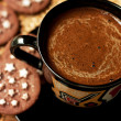 Closeup of chocolate cookies and a cup of coffee — Stock Photo