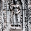 Apsara carved on the wall of Angkor Wat, Cambodia — Stock Photo #14052546