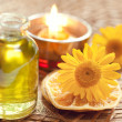 Stock Photo: Essential oils for aromatherapy and yellow flowers