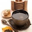 Asian tea set with dried green tea — Stock Photo