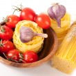 Italian pasta, tomatoes and garlic — Stock Photo