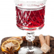 Stock Photo: Glass of mulled wine with spices on white background