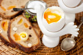 Boiled egg and whole grain bread with nuts and fruit — Foto de Stock
