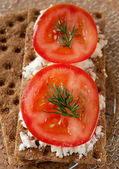 Crispy rye bread, cheese, tomato and herbs — Stock Photo