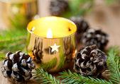 Christmas burning candle — Stock Photo