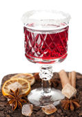 Glass of mulled wine with spices on a white background — Foto de Stock