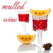 Two glasses of mulled wine, spices and orange slices — Stock Photo