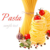 Italian pasta with tomatoes and spices on a white background (with sample text) — Stock Photo
