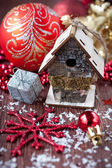 Christmas balls and baubles, bird-house and snowflakes. — Stock Photo