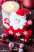 Santa Claus and Christmas candle — Stock Photo