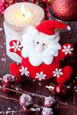 Santa Claus and Christmas candle — Stockfoto