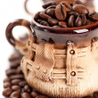 Stock Photo: Coffee beans in a cup