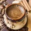 Cup of coffee with spices and chocolate — Stock Photo