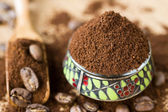 Coffee ground and in the grain — Stock Photo