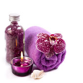 Spa concept ( Orchid, sea salt, candle and towel) — Stock fotografie
