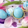 Stock Photo: Easter eggs, pink tulips and petals
