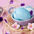 Royalty-Free Stock Photo: Easter eggs in a bowl, decorated with colorful flowers