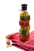 Chili pepper in a glass bottle and spices — Stock Photo