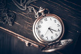 Vintage pocket watch on a chain — Stock Photo
