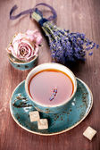 Сup of tea a bouquet of lavender — Stock Photo