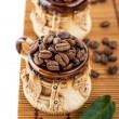 Mugs with coffee beans — Stok fotoğraf