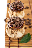 Mugs with coffee beans — Stock Photo
