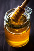 Honey dripping from a spoon — Stock Photo